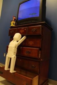 Child climbing a dresser