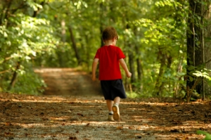 boy walking in woods