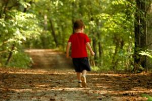 boy walking in woods