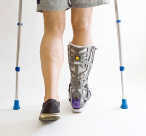 Man with a broken leg  walking on crutches