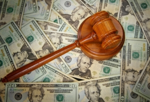 court gavel on U.S. Twenty dollar bills